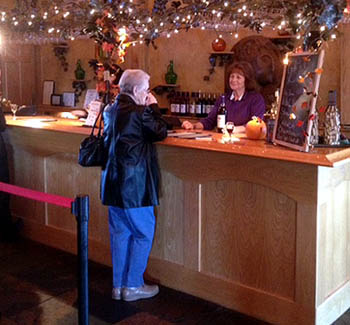 A small tasting bar greets visitors as they step into the large lodge-like winery.