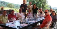 2014 group having fun tasting the wines of Alexana Winery in a beautiful outdoor setting.