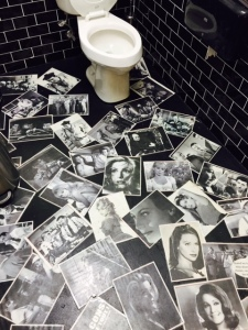 The whimsical floor of the men's room - covered in photos from French films.